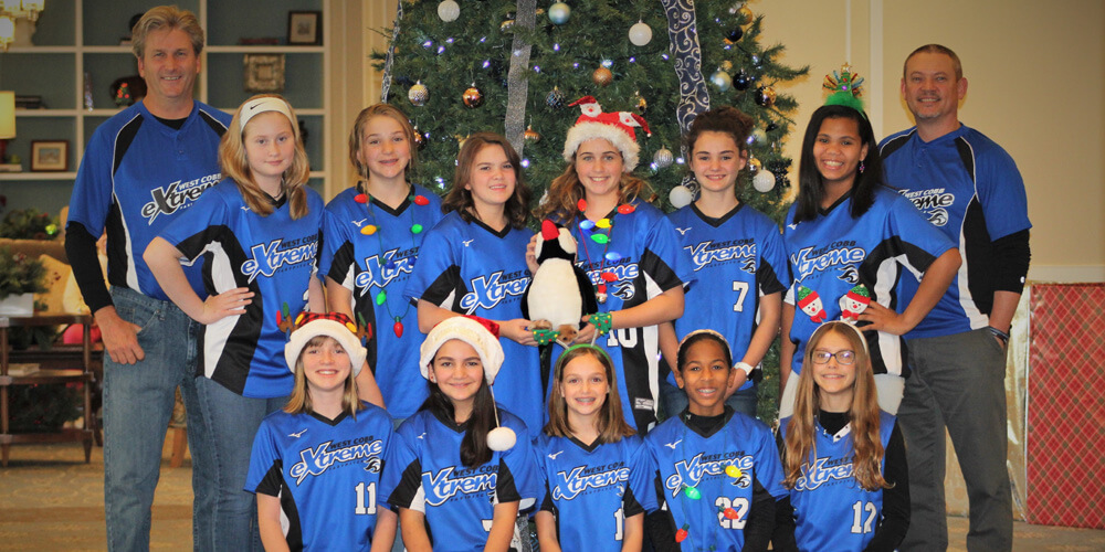 West Cobb Extreme 12U 07 Softball Team Spreads Holiday Cheer at Sterling Estates